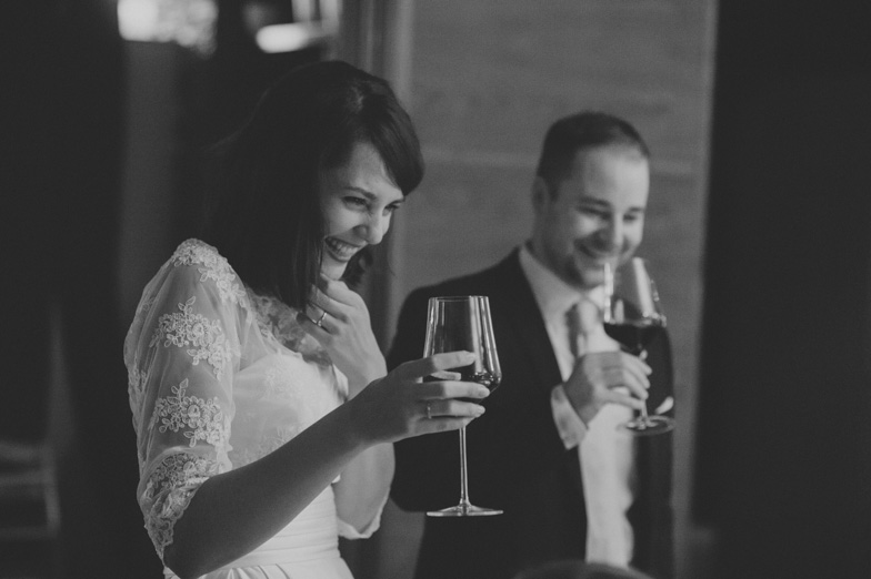 The bride and groom during proposing toast with wine.