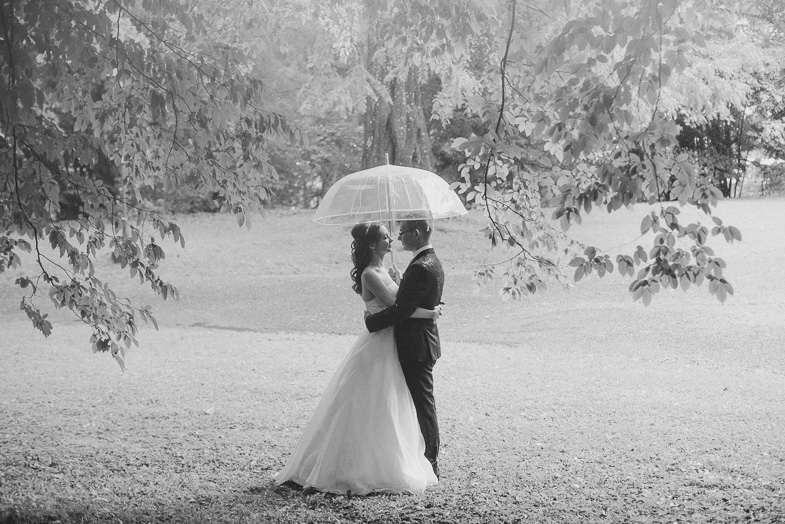 The bride and groom who have hired a wedding photographer.