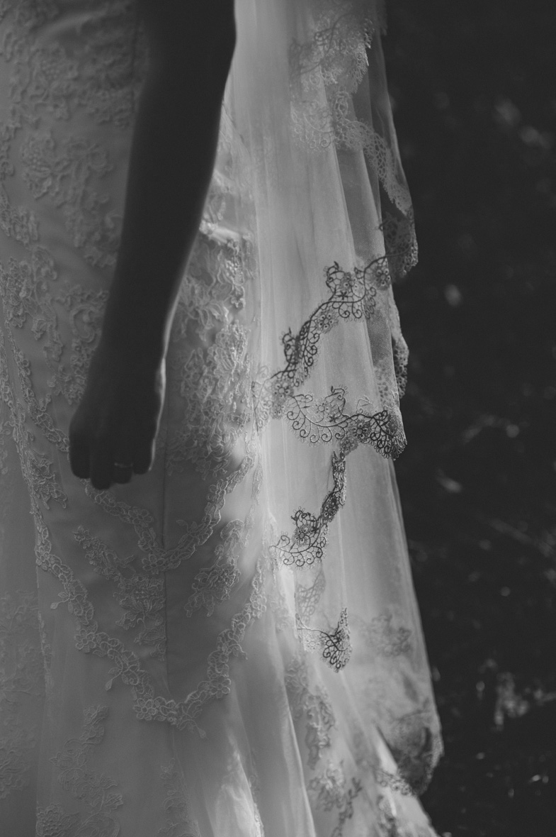 A detail of a white wedding dress with a veil.