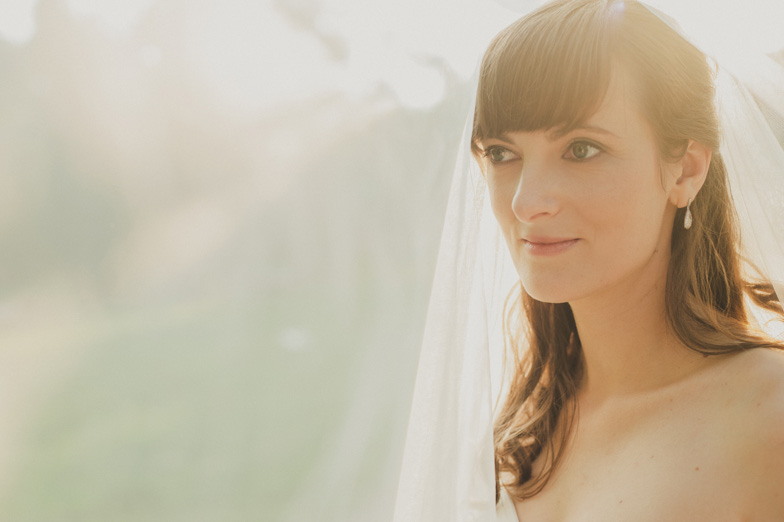 A wedding portrait of a bride in white.