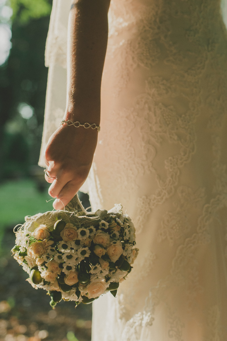 Photo of a wedding bouquet and jewelry.