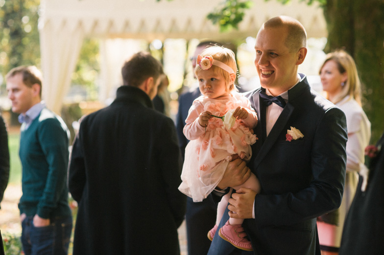 A wedding photo of a groom with her daughter.