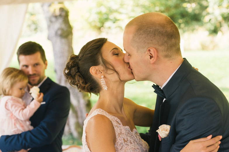 Moment of a wedding kiss.