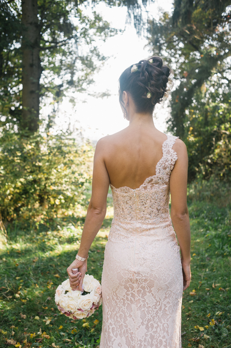 Photo of lace wedding dresses in peach color.