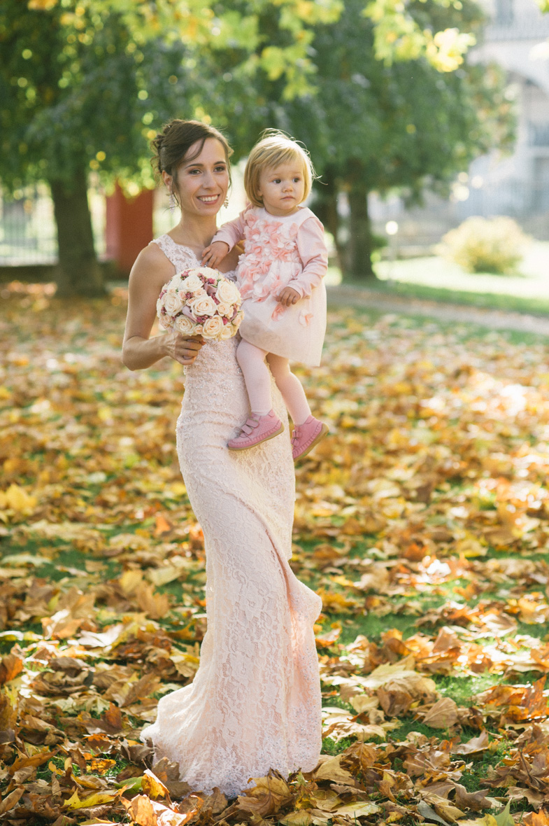 A wedding portrait of a bride with a child.