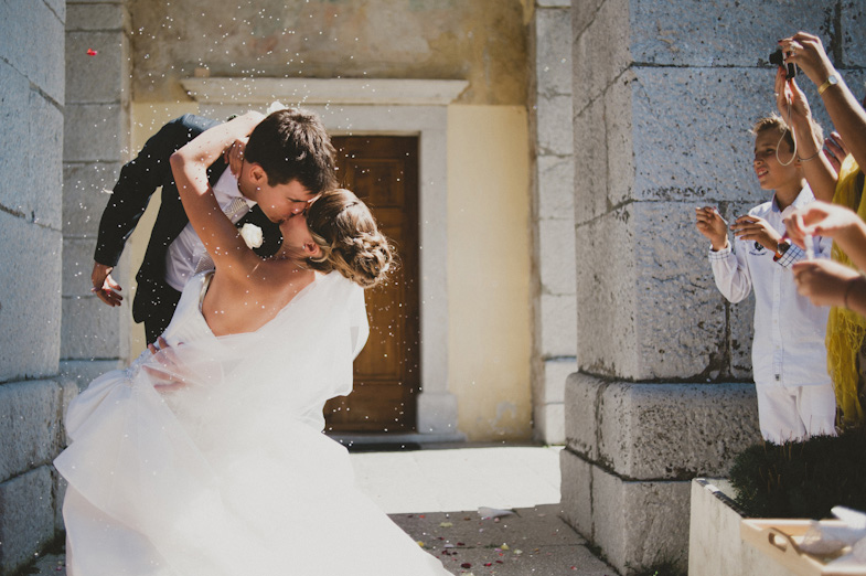Photo of kissing bride and groom.