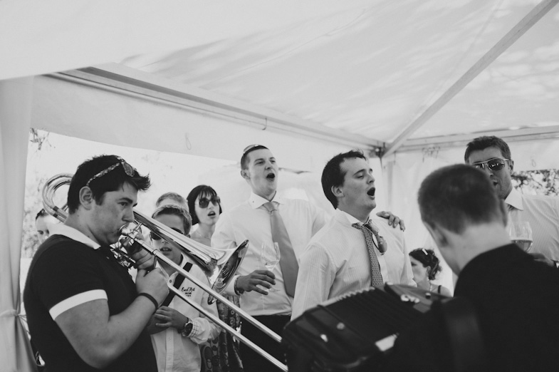 Playing musicians at a wedding.