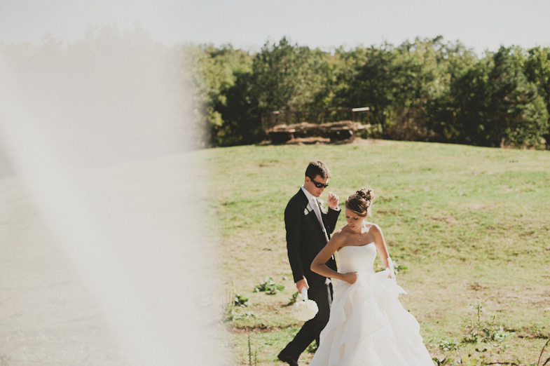 A groom and bride who hired a wedding photographer.