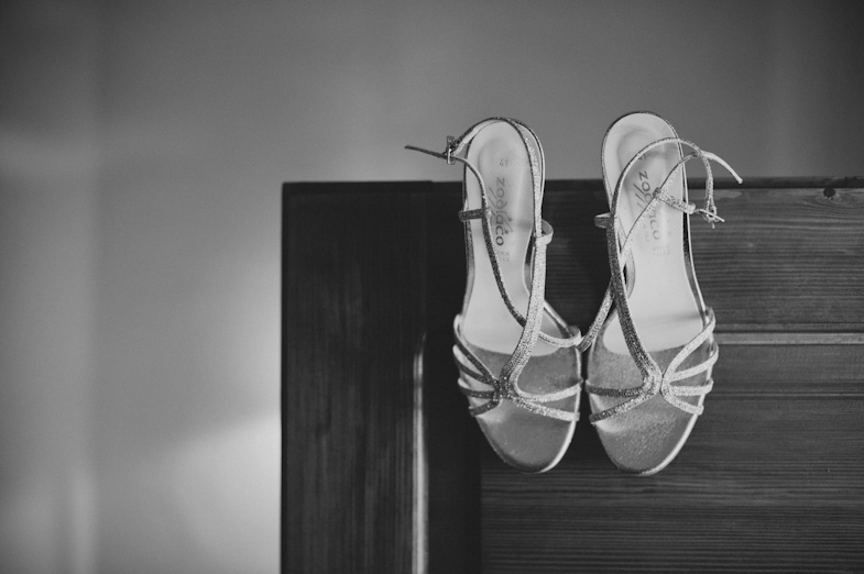 Glittering wedding shoes with heels.