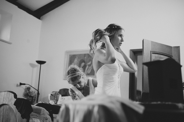 Portrait of bride in wedding dress during preperations.