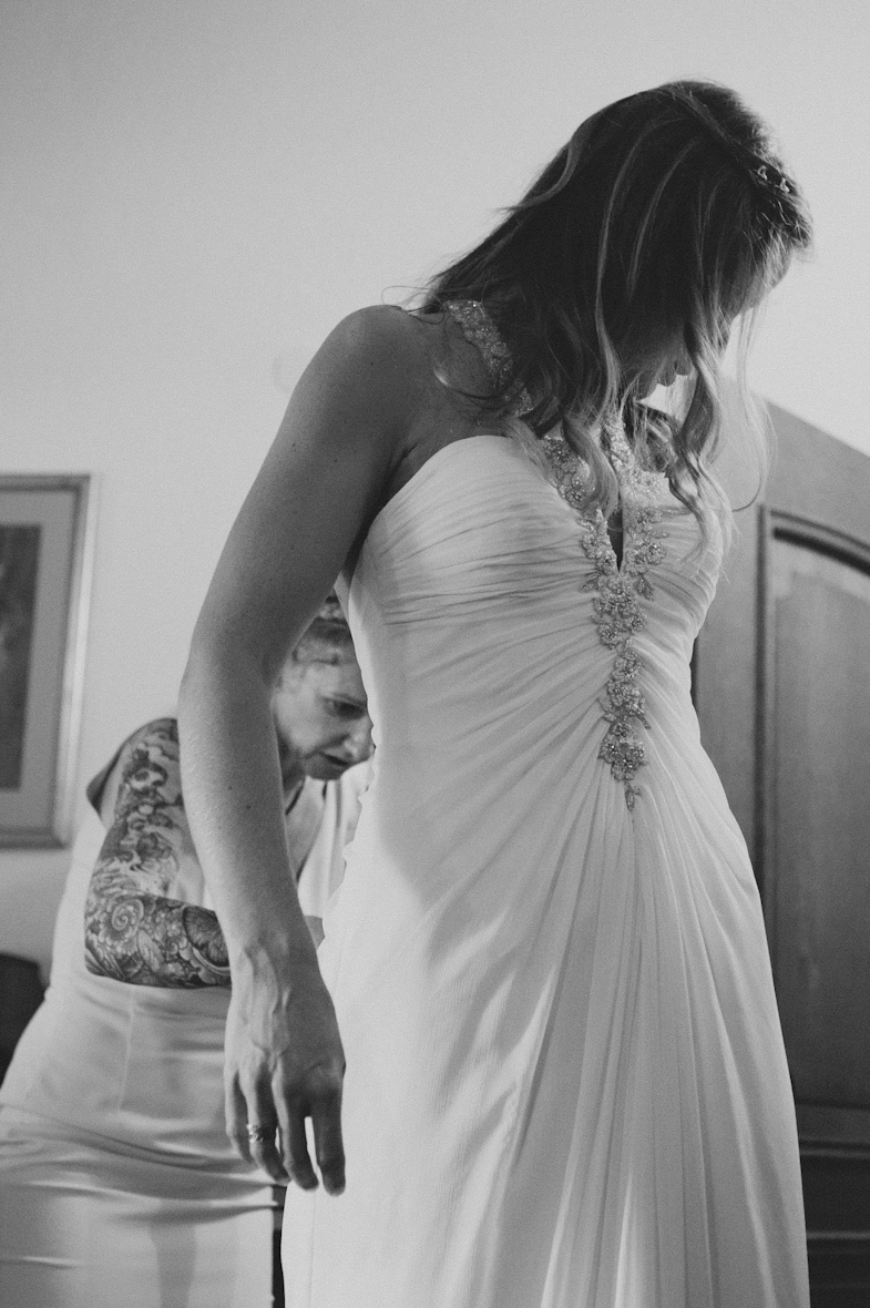 Bride and her sister, who helps with her wedding dress.