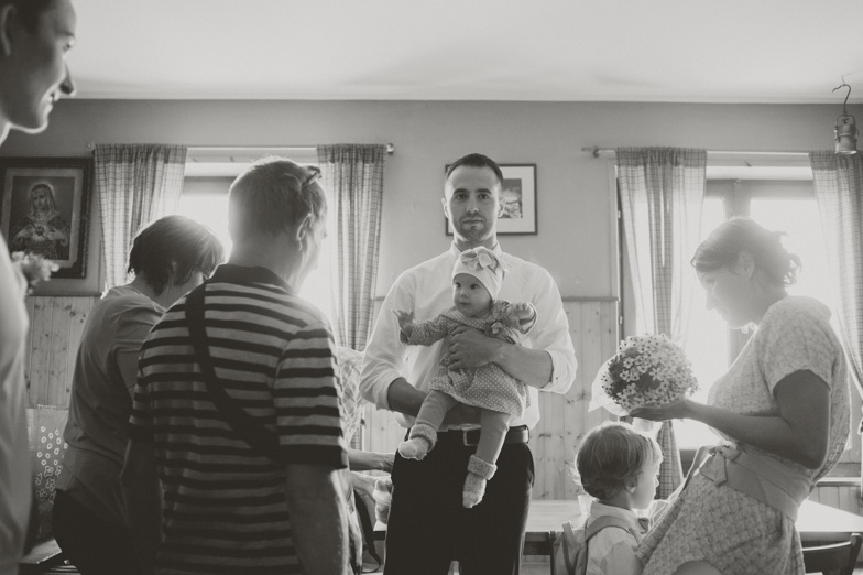 Portrait of the groom with the baby.