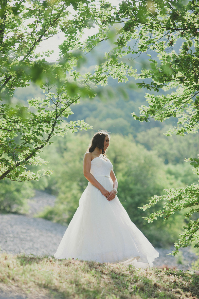 Wedding photography with the bride by Soča river in Tolmin.