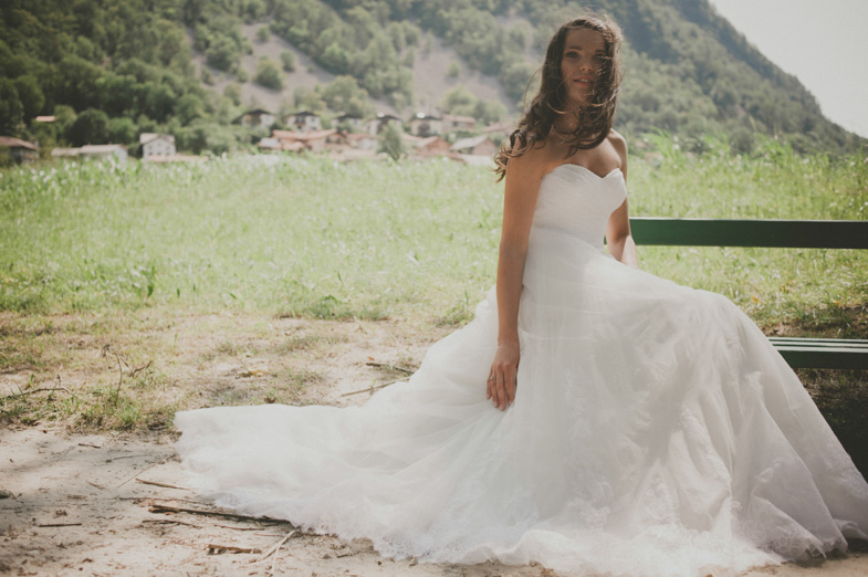 Bride and her long white wedding dress.