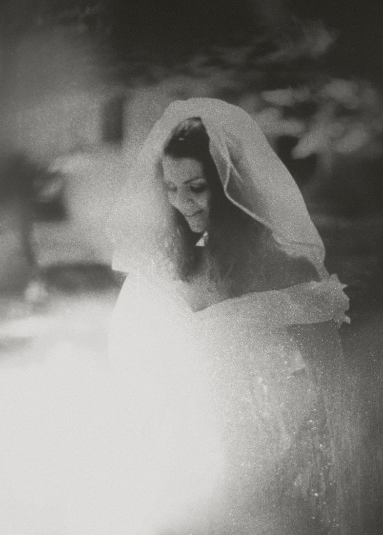 Photo of a bride in a wedding dress with a veil.