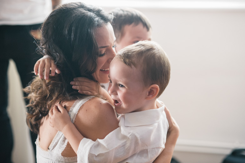 Photo of a bride with her child.