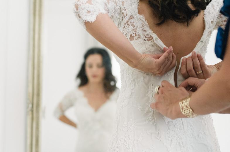 Closing a zipper on a wedding dress.