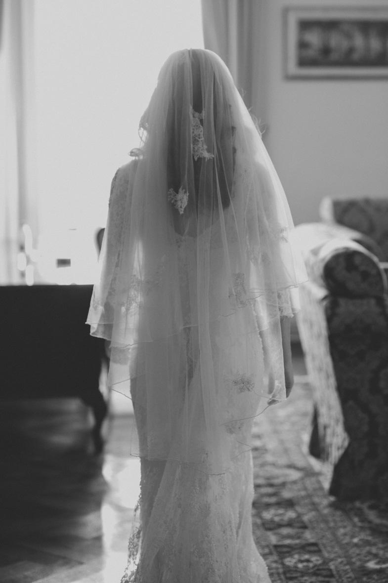 A white wedding dress with a veil.