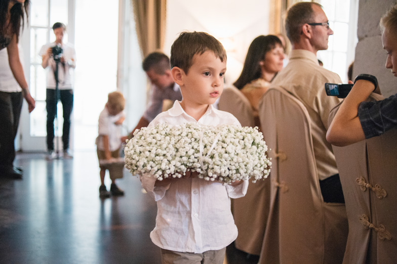 Photo of a boy with flowers at the wedding.