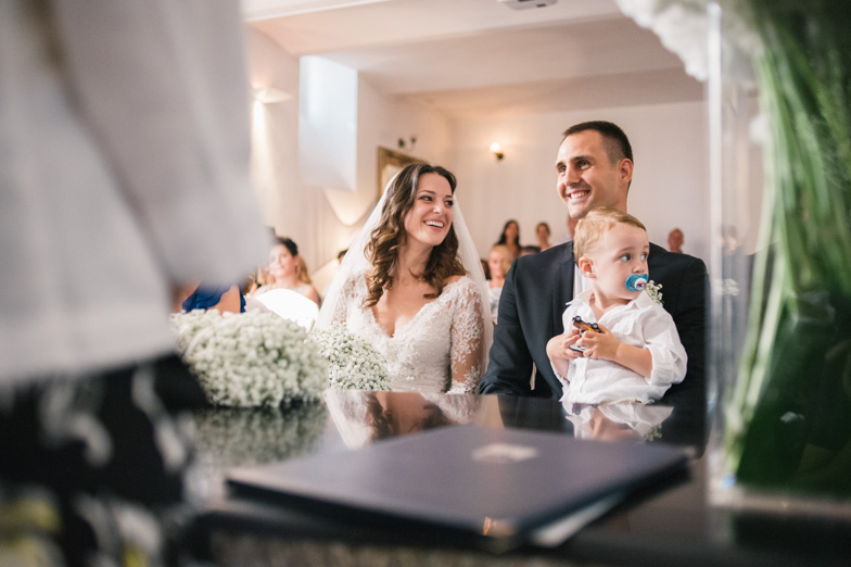 Portrait of bride and groom with the child during the wedding ceremony.