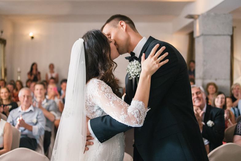 Photo of a wedding kiss.