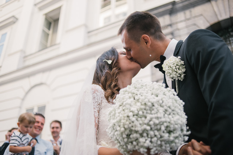 Portrait of bride and groom during kissing.