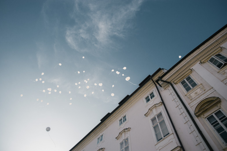 Dropping balloons into the sky at the wedding.
