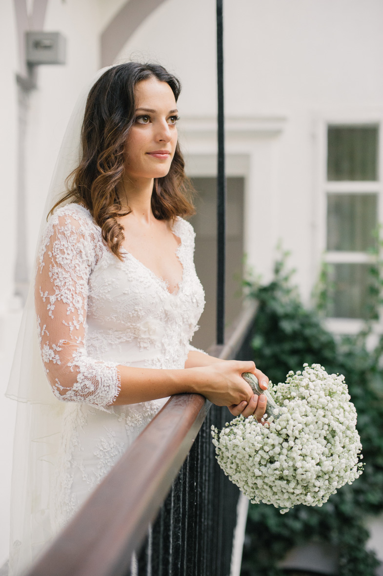 Photo of bride with wedding bouquet.