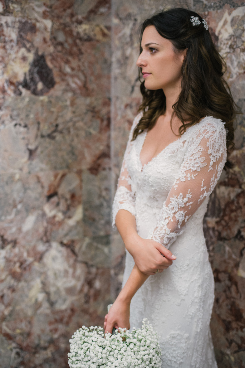 Photo of romantic wedding dress with lace sleeve.
