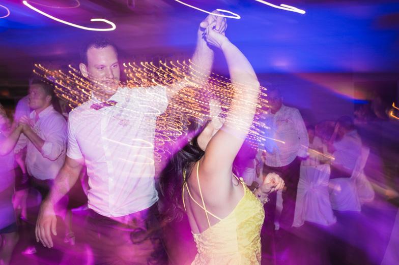 Fun and dancing guests at wedding.