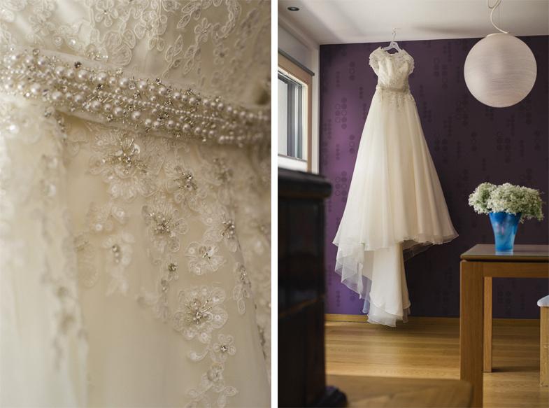 Fotografija razkošne poročne obleke s čipko.