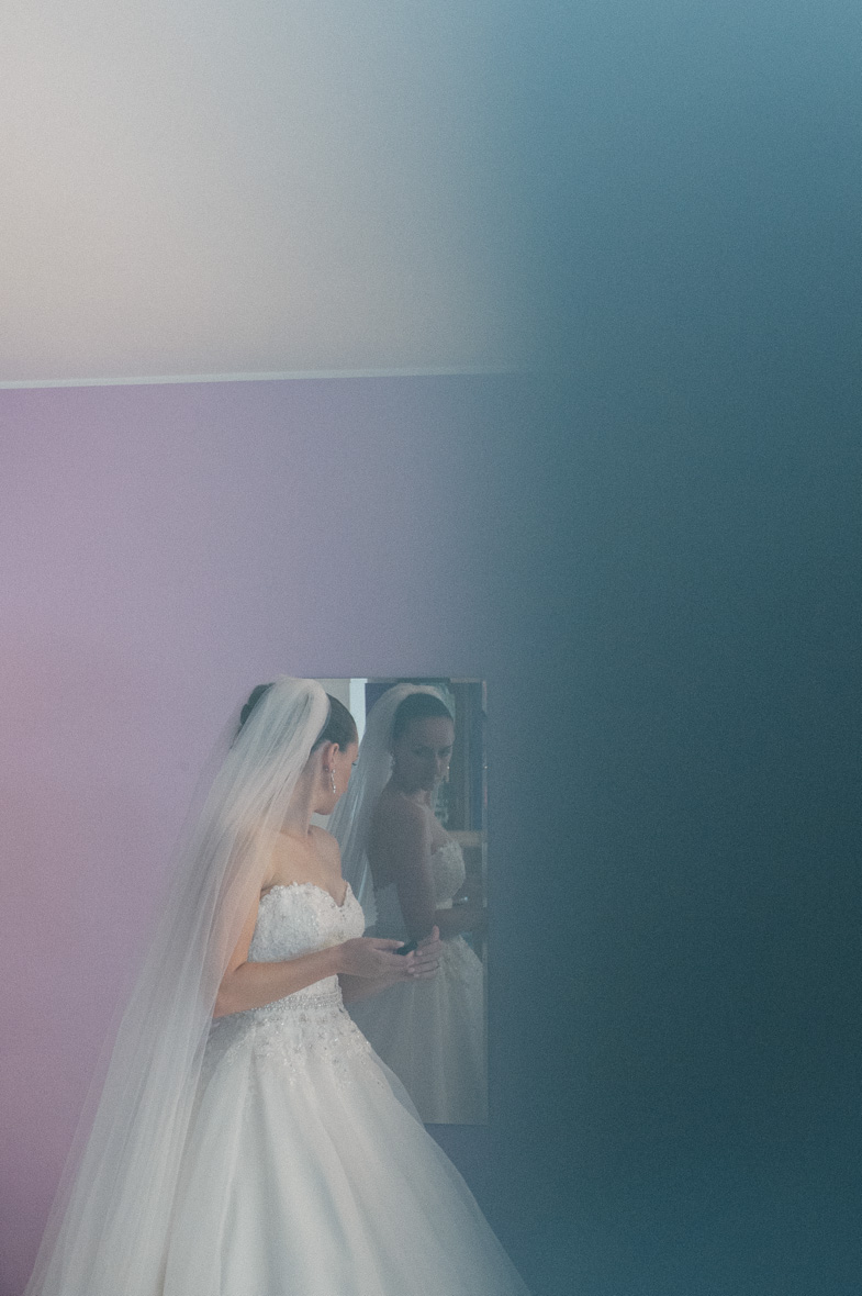Photo of the bride in wedding dress with bridal veil.