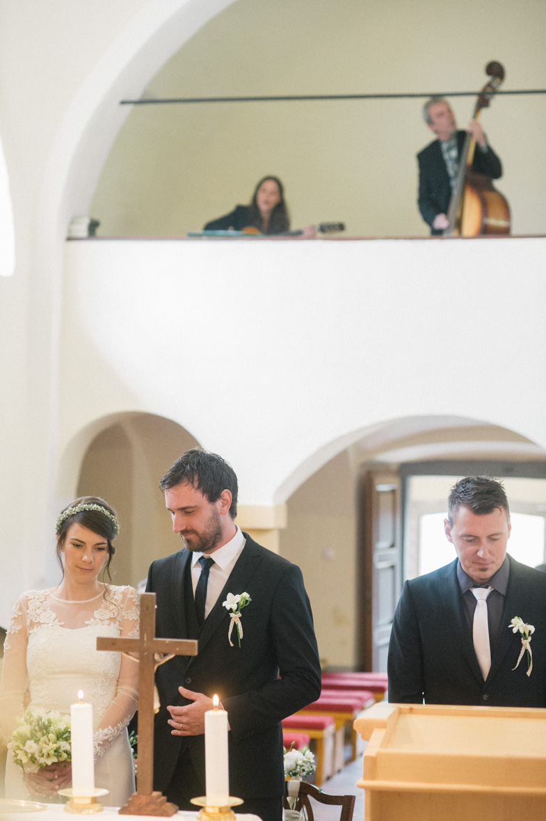 A moment of listening to music during a church wedding.