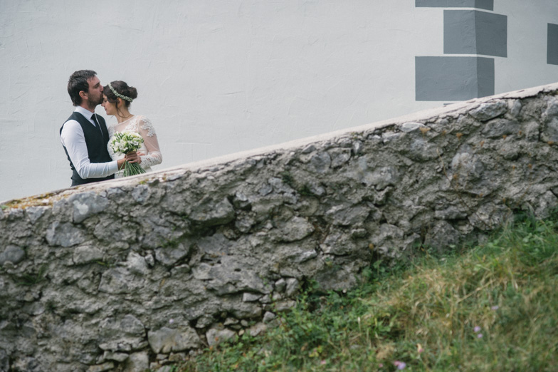 A photo of a couple who hired a wedding photographer.