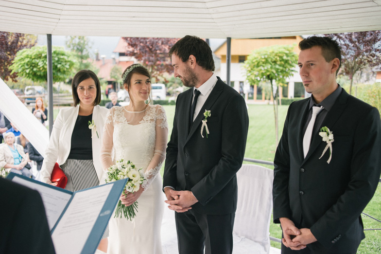 The groom and the bride with witnesses during the civil part of the wedding.