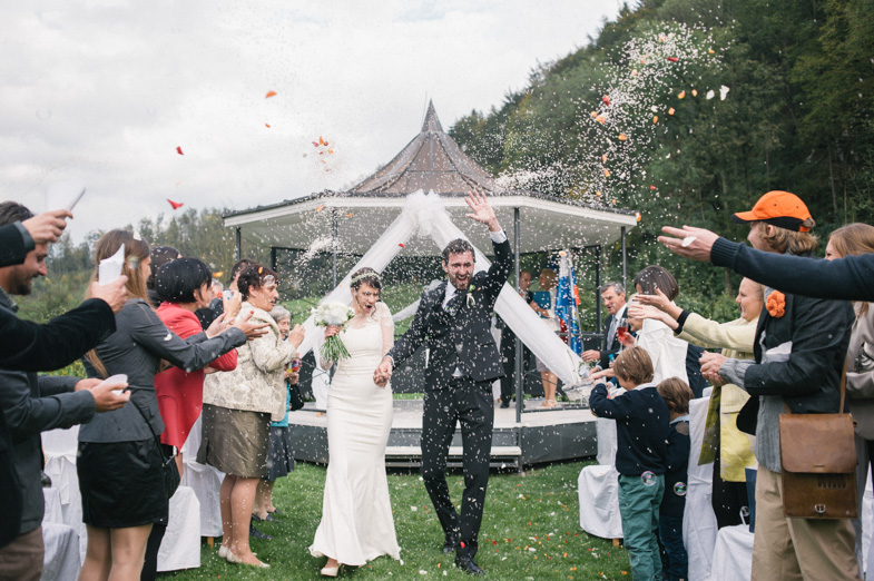 Throwing rice at a wedding.