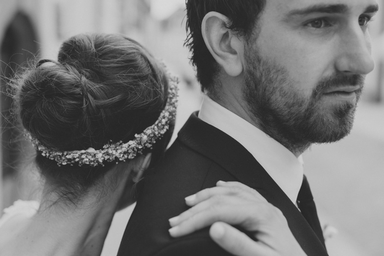 Black and white wedding photograph of groom and bride.