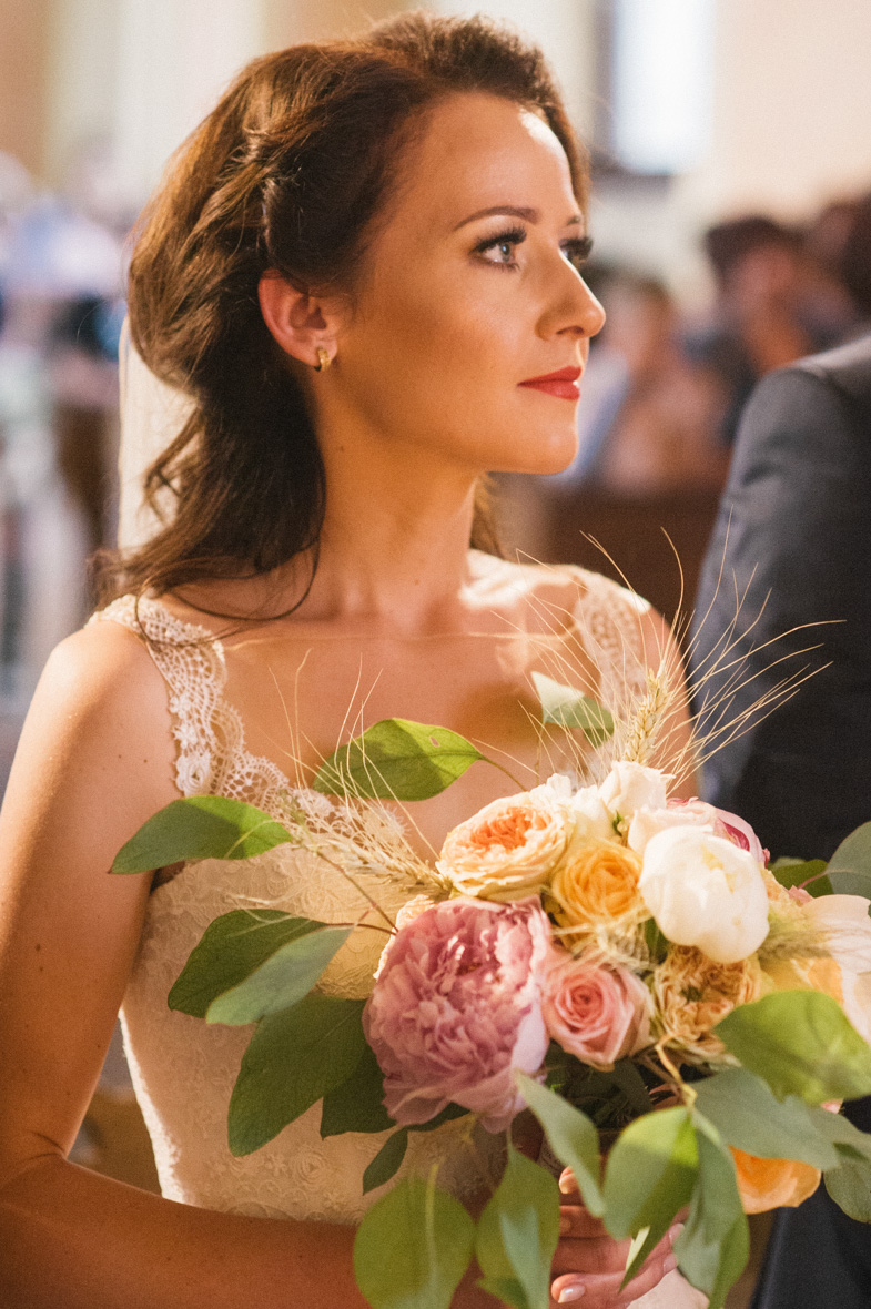 Portrait of bride with wedding bouquet.