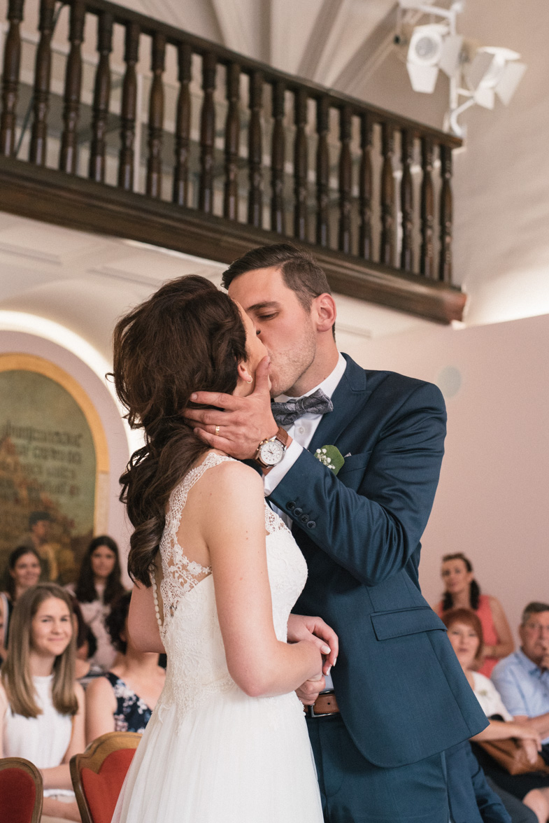The moment a groom kisses a bride.
