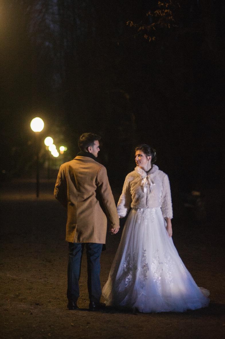 Bride in winter wedding dress with bolero.