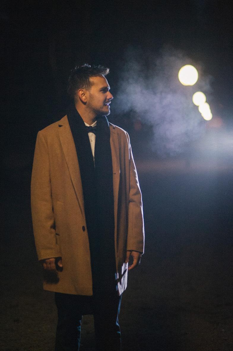 Portrait of a groom in a winter wedding coat.