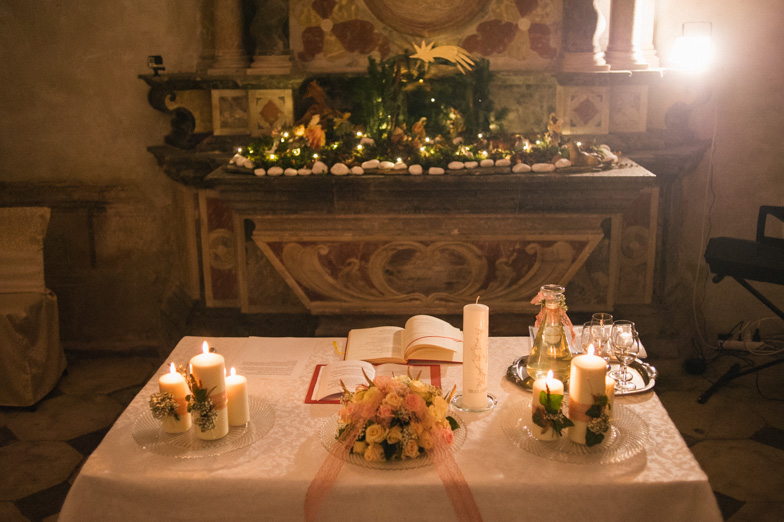 Photo of the wedding decorated church altar.
