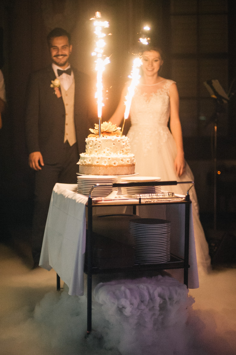 Photo of a wedding cake with sparks.
