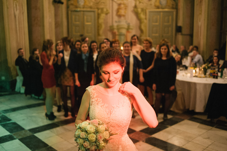Portrait of a bride while throwing a bouquet.