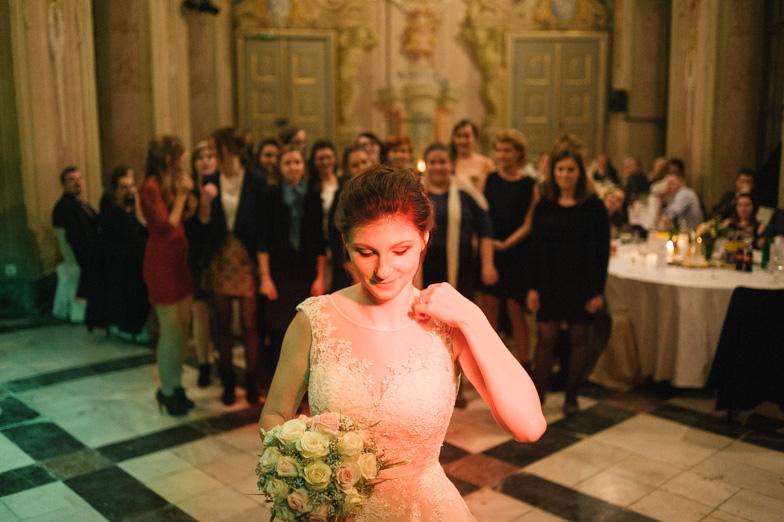 Portrait of a bride while throwing a bouquet.