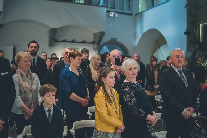 Wedding guests at the location of a civil wedding at the SAZU atrium in Ljubljana.