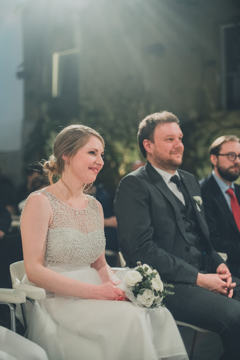 An example of a formal wedding photograph of newlyweds during the ceremony.