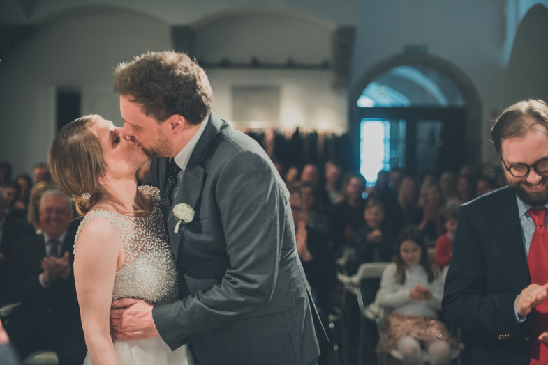 A groom and bride during the first kiss.