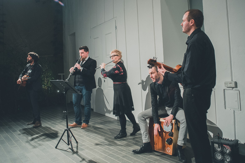 band is performing music at a wedding ceremony.
