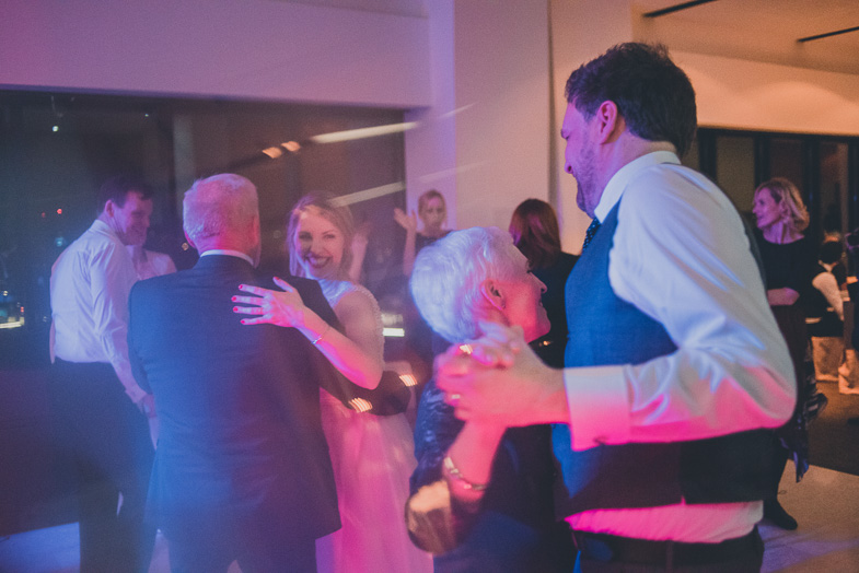 Bride and groom are dancing with thier parents.
